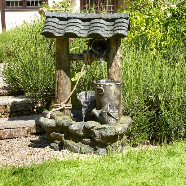 Еще один вариант необычного колодца с фонтанчиком
